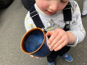 Boy with ceramic cup in his hand